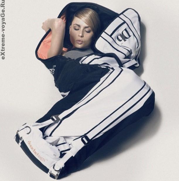 Девушка в сумке Douchebag